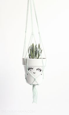 DIY-ify: $5 Macrame Plant Hanger | http://www.bhg.com/blogs/better-homes-and-gardens-style-blog/2014/05/15/macrame-plant-hanger/