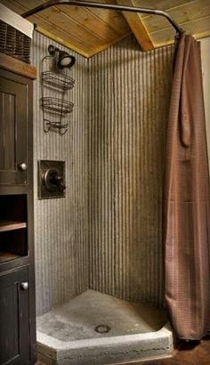 Corrugated tin in the shower. Very rustic very cute. Needs a little more light, maybe a white shower curtain instead