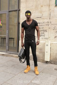 Men's Street Style | All about the Sunglasses - To nail this look you need a black pair of super skinny jeans, a black t-shirt and a gold pair of Timberland Boots. Add a beanie and some shades.| Shop the look at The Idle Man