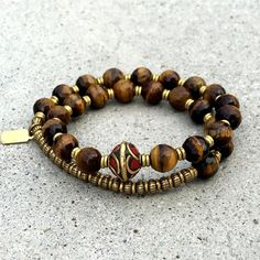 Faceted Tiger's eye wrist mala with Tibetan center bead, cool boho chic fashion, earthy and perfect for the everyday! #malas