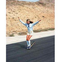 70's girl hang ten on a skateboard