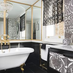 Glamorous bathroom with black floor tiles