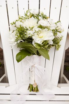 This bouquet is quite beautiful. Wrapped in burlap and twine with some lavender perhaps?