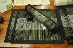 Cotton/straw placemats, available in black/neutral.  LAD-  £5.50 each.  Matching table runner, £20.95.  Charlie6.