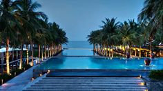Four Seasons Resort The Nam Hai in Hoi An, Vietnam is a luxury beach resort. Four Seasons Resort The Nam Hai has luxurious villas, a private beach & deluxe spa. Hotel Swimming Pool, Cool Swimming Pools, Hotel Pool, Vietnam Voyage, Vietnam Travel, Hanoi, Beautiful Pools, Beautiful Places, Piscina Hotel