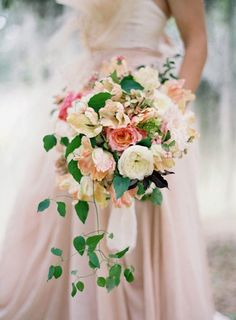 This dusty rose + pink cascading bouquet is perfect for a wedding.