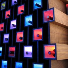 Beautiful wine storage design...I love the colorful lighting!!