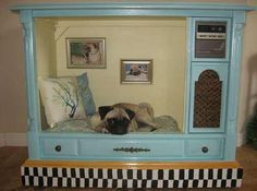 Doggie boudoir from an old console TV set!  Upcycling at its best.