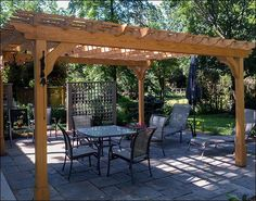 outdoor living pergola built using post bases rafter. Black Bedroom Furniture Sets. Home Design Ideas