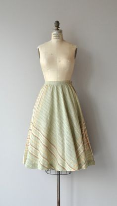 Vintage 1970s woven gauzy cotton blend skirt with banded waist and side zip closure. --- M E A S U R E M E N T S ---  fits like: small waist: 27 hip: