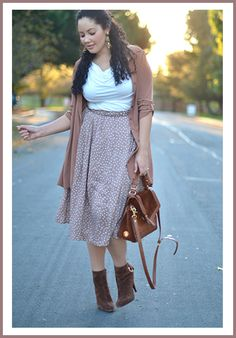 Love the shirt and skirt combo with the boots.  Probably wear with a turquoise or navy cardigan. {Fashion Friday} Girl With Curves: Proving How Fashionable Curves Can Be || Pretty Pear Bride