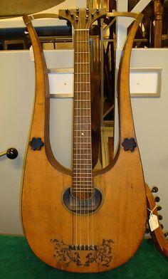 Lyre Guitar  Gennaro Fabricatore  (Italian, Naples ca. 1750–1832 Naples)  Date:    1807  Geography:    Naples, Italy  Medium:    Spruce, maple, ebony