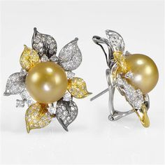 Earrings by Scapin Joias. 18 k gold, diamonds and South Sea pearls.