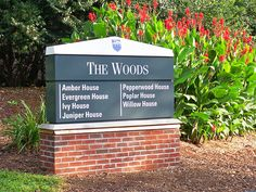 College Campus Exterior Building Identification Sign with brick base