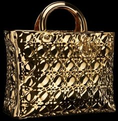if you really wanna have a stand-out bag which SPARKLES ALL NIGHT, i'm sure this Lady Dior bag won't disappoint you. somehow it looks like those LV monograms as well, just not as expensive, i guess :p