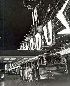 Vintage Las Vegas Photo ~1950's Gray Line tour / party bus group posing in front of the Stardust Casino.