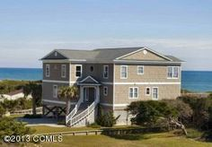 MLS #15-184 | 101 Knollwood Drive, Pine Knoll Shores, NC | FANTASTIC OCEANFRONT HOME LOCATED IN PINE KNOLL SHORES. OUTSTANDING REVERSE FLOOR PLAN PROVIDES PANORAMIC OCEAN VIEWS INCLUDING AN AWESOME UNRESTRICTED VIEW OF ATLANTIC BEACH. CAPE LOOKOUT CAN EVEN BE SEEN ON A CLEAR DAY. THERE ARE 3 MASTER SUITES EACH WITH A JACUZZI, BONUS ROOM ON THE TOP LEVEL. COVERED AND OPEN DECKING, ELEVATOR, POOL, HOT TUB.BEAUTIFULLY FURNISHED AND PROFESSIONALLY LANDSCAPED. CLOSE TO SHOPPING AND GOLF COURSES.