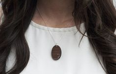 INLAY ECLIPSE A wood pendant with an abstract pattern of 5 .925 Silver dots. A great everyday piece and perfect 5 Year Wedding Anniversary gift! #Jewelry #WoodJewelry #5YearAnniversary #Fashion #Minimal #Silver #Wood #Necklace