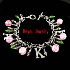 Greek AKA Sorority  pink and green crystal bead  Alpha Kapp Alpha Letter Charm Bracelet JewelryDeep discounts on over 300 products that enhance your life from day to day! Items for men and women of all ages, also teenagers. Take a look at our #jewelry #handbags #outerwear #electronicaccessories #watches #umbrellas #gpspettracker  #Songbirddeals #sunglasses #Purses