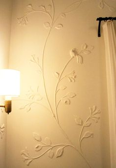 California-based Maria Apelo Cruz creates plaster pieces, then puts them on walls for either a white-on-white look or to be painted over for an incredible texture addition to any area.  With all the molds available, this certainly opens up the application possibilities....especially in kids rooms!