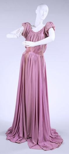 """Evening Dress, Charles James (American, born Great Britain, 1906–1978): spring/summer 1946, American, silk, leather. """"...Millicent Rogers was an important James client for whom he designed from the mid-1930s until her death in 1953. They collaborated on many of the designs for her dresses, Rogers suggesting fabric, color and sometimes cut. The collection holds a total of 65 of her garments by James and 78 supporting materials used in the creation of them..."""""""
