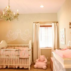 Soft pinks and beiges, elegant beauty in this nursery.