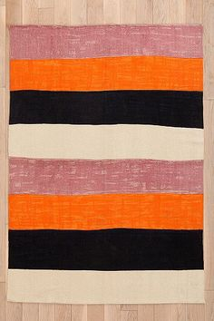 Char-Bea By Ashley G Stripe Rug.  I don't usually like black and orange together, but here I think it looks good.
