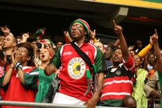 Fans cheering the Kenyan Rugby 7's team.
