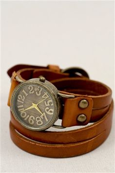 "$28 Wrapped In Time Leather Cuff Watch. This little leatherette cuff bracelet watch is a Three Bird Nest best seller. This bracelet cuff + watch with antiqued brass face and buckle closure will have you wrapped up. Length measures 16"", case measures a 1.5"" diameter."