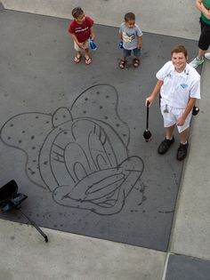 Hayes is One of 15 or so Cast Members Who Has Learned to 'Paint' Mickey, Minnie and Other Classic Disney Characters Using Nothing More Than His Broom and Water  tami@goseemickey.com