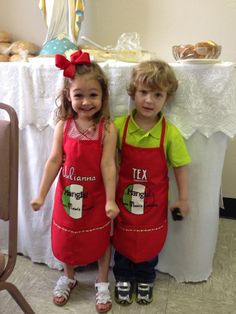 Cute Little Italian cousins at St. Joseph's Day Celebration. Hand painted aprons.