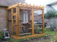 wooden cat enclosure with real tree cat tower.....maureen this would be wonderful for daniel and anthony