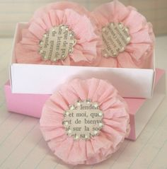Sweet, girly book paper adorned homemade rosettes/flowers. #flowers #rosettes #paper_crafting #DIY #scrapbooking #crafts