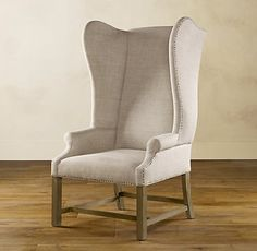 Restoration Hardware wing chairs in linen.  I noticed they used furniture tacks instead of studs on the side, I might do the same with mine...
