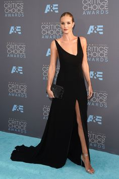Rosie Huntington-Whiteley in an asymmetric black gown and bold lip at the Critics' Choice Awards