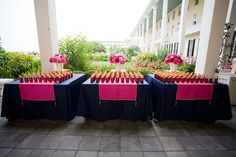 Reception: Favors table. Navy blue and fuschia pink.