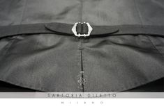 Sartoria Diletto: Waistcoat. Details: the back of the waistcoat in black silk and the silver size-adjuster.