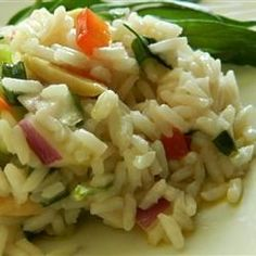"""Louisville Rice Salad I """"Made this for a family dinner and everyone loved it and wanted the recipe. I added toasted almonds, raisins, peas, bell pepper and onion."""""""