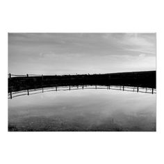 Dewpond :- This is an old dew pond high up on Telscombe Tye (an area of open land with the status of common, extending from Telscombe village to the coast), Sussex, England. #pond #dewpond #reflection #fence #mirrored #natural #water #blackandwhite #monochrome #abstract