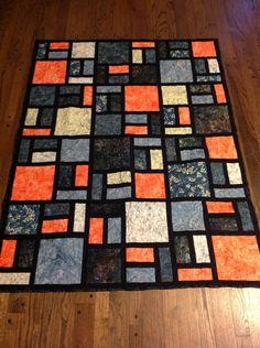 Batik 47x62 orange, blue, black quilt. $135.00, via Etsy.