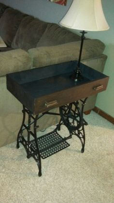 From another pinner: My Great Grandma's sewing machine legs and an old drawer I painted. Awesome new sofa table.