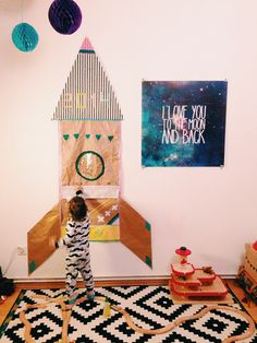 Wow. Did a space theme for our little guys nursery and chose the same rug and a moon print. Coinkydink.