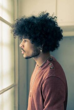 its something about a handsome man of color with his Natural hair, so Divine