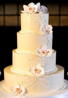 The Mandy- Buttercream wedding cake with sugar orchids. More