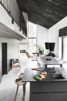 thinking against the mezzanine unless awesome, like concrete floor and white