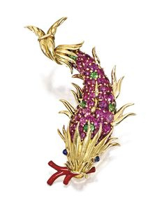 18 Karat Gold, Colored Stone and Enamel Fish Brooch, Schlumberger for Tiffany & Co. -  The fish set with numerous pink sapphires and green tourmalines, with two cabochon sapphire eyes and an enamelled branch resembling coral, signed Tiffany Schlumberger