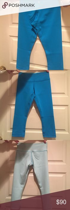 Lululemon Athletica Cropped Leggings Size 2 Aqua/Teal color. Reversible to a blue-ish white color. Very soft. Never worn. Sweat-wicking, flexible pants. Great for running, yoga, or hanging out. lululemon athletica Pants Leggings
