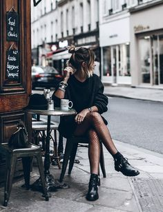 Black dress, sheer stockings, black boots