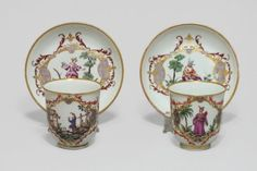 """Doccia (Italy) - Two decorated cups """"alla Sassone"""" - Eighteenth Century  Doccia (Italy) - Two cups and saucers decorated with polychrome and gold called """"alla Sassone"""" in the style of Meissen a character appearing on landscape background surrounded by foliage and rock gold"""