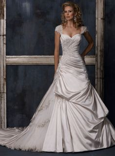 Maggie Sottero - Cassandra. Sadly, not made anymore. I wanted to try this one on SO badly.